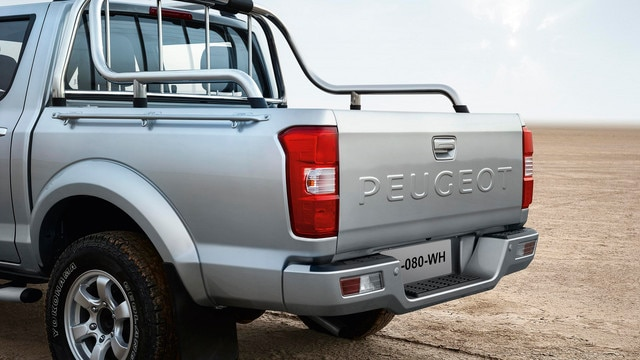 The PEUGEOT lettering stamped on the rear panel echoes its illustrious forebears, PEUGEOT 403 Covered Pick-up, PEUGEOT 404 Covered Pick-up, and PEUGEOT 504 Pick-up.